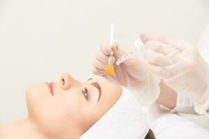 Relaxed female patient undergoing chemical peel in Chicago