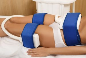 Woman undergoing professional CoolSculpting procedure at med spa